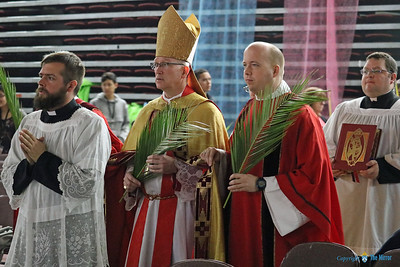 PALM SUNDAY—Fr. Joseph Kelly, associate pastor of Our Lady of the Lake Parish, Branson, and Our Lady of the Ozarks in Forsyth; Bishop Edward M. Rice; and Rev. Mr. Brian Straus, seminarian, get ready to process into liturgy March 25, Palm Sunday, at DYC. (Photo by J.B. Kelly/The Mirror)