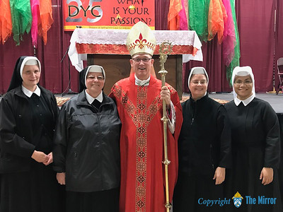 WOMEN RELIGIOUS—Sr. Clare, Sr. Michael, Sr. Rudolfia, Sr. Seraphia of the Daughters of of St. Francis of Assisi from St. Francis Hospital in Mountain View, MO, were pictured with Bishop Edward M. Rice at the 25th Annual Diocesan Youth Conference (DYC) in West Plains. (Photo by Margie Black/The Mirror)
