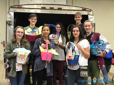 SERVICE PROJECT—Attendees at the 25th annual Diocesan Youth Conference March 23-25 brought baskets, candy, and non-perishable food items, in order to put together close to 100 Easter baskets that were delivered to Samaritan Outreach Center in West Plains. (Photo by Margie Black/The Mirror)