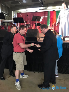 "ROCK, PAPER, SCISSORS—Sr. Karolyn attempted to mediate a rather ""heated"" Rock, Paper, Scissors battle during the 25th Annual DYC held March 23-25 in West Plains, in which many priests felt called to participate, including Fr. J. Friedel, Fr. Colby Elbert, and Fr. Scott Sunnenberg. (Photo by Margie Black/The Mirror)"
