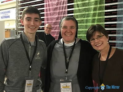 "25TH ANNUAL DYC—The 25th Annual Diocesan Youth Conference (DYC) was held March 23-25 in West Plains. In this photo, DYC keynote speaker Sr. Karolyn Nunes, FSGW, posed with Ben and Tracy Borgmeyer, of Joplin, with ""photo bomber"" Bishop Rice in the background. Bishop Rice and Sr. Karolyn got into a LipSync Battle over the weekend, so click HERE to see Bishop sing. (Photo by Margie Black/The Mirror)"