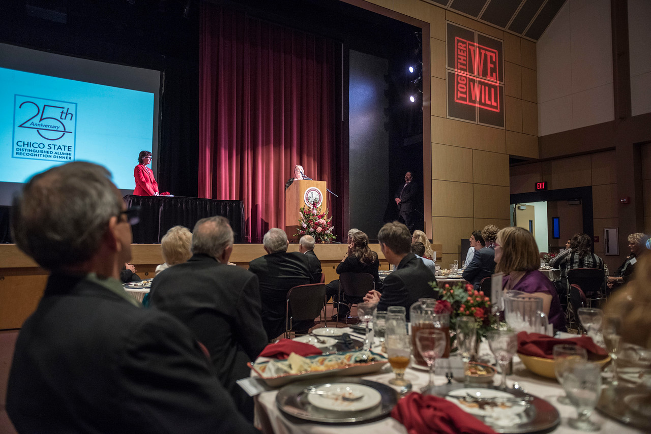 President Gayle Hutchinson (left) recognizes Distinguished Alumni recipient Valerie Lucero (NURS, '83) (right) during an evening dinner on Friday, March 9, 2018 in Chico, Calif.  (Jason Halley/University Photographer/CSU Chico)