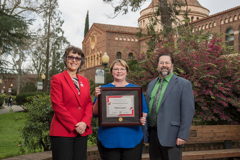 President Gayle Hutchinson, Natural Sciences 2018 Distinguished Alumni Valerie Lucero (NURS, '83), David Hassenzahl (Dean, NS) (left to right) take a photo after the presentation of plaques on Friday, March 9, 2018 in Chico, Calif.  (Jason Halley/University Photographer/CSU Chico)