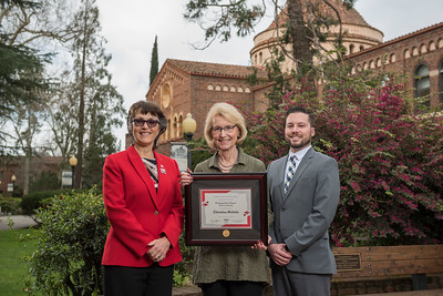 President Gayle Hutchinson,  2018 Distinguished Alumni Volunteer Service Award Chris Nichols (HIST, '69), Aaron Skaggs (left to right) take a photo after the presentation of plaques on Friday, March 9, 2018 in Chico, Calif.  (Jason Halley/University Photographer/CSU Chico)