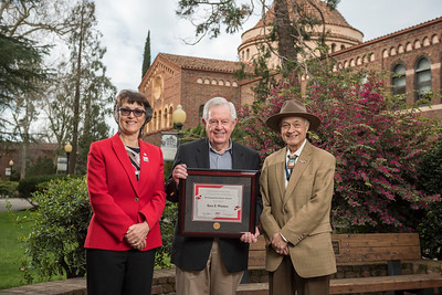President Gayle Hutchinson, Engineering, Computer Science, and Construction Management 2018 Distinguished Alumni Gary Watters (CIVL, '57), Ricardo Jacquez (Dean, ECC) (left to right) take a photo after the presentation of plaques on Friday, March 9, 2018 in Chico, Calif.  (Jason Halley/University Photographer/CSU Chico)