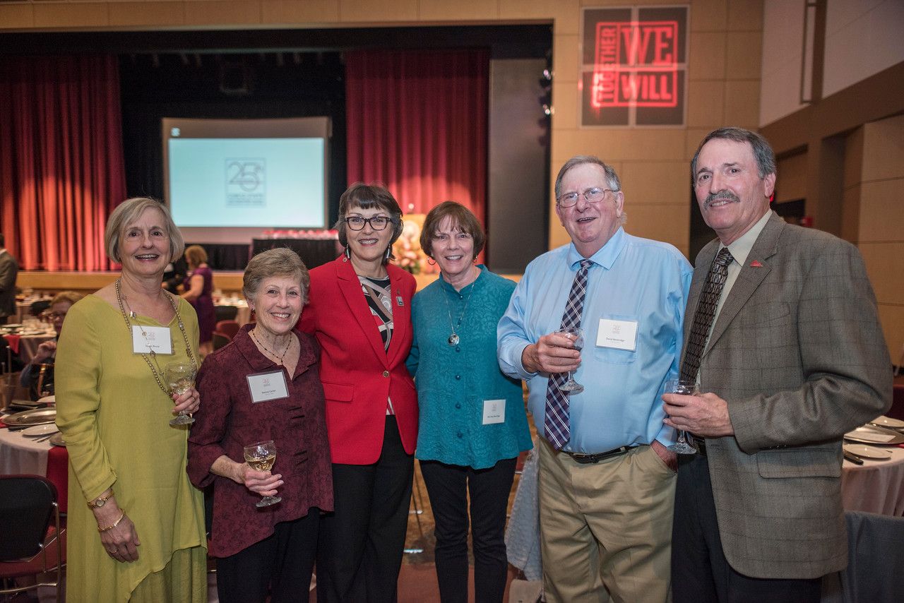 Susan Bruce, Donna Carter, President Gayle Hutchinson, Merrieta Beveridge, David Beveridge, and Tom Carter (left to right) attend the Distinguished Alumni dinner on Friday, March 9, 2018 in Chico, Calif.  (Jason Halley/University Photographer/CSU Chico)