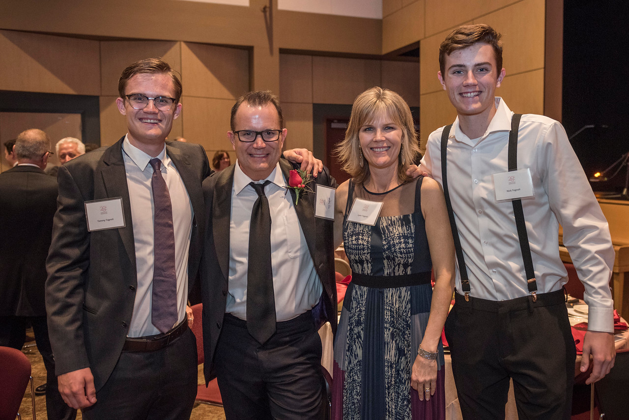 Distinguished Alumni Tom Tognoli (FNMK, '88) (second from left) takes photos with his family after being recognized during an evening dinner on Friday, March 9, 2018 in Chico, Calif.  (Jason Halley/University Photographer/CSU Chico)