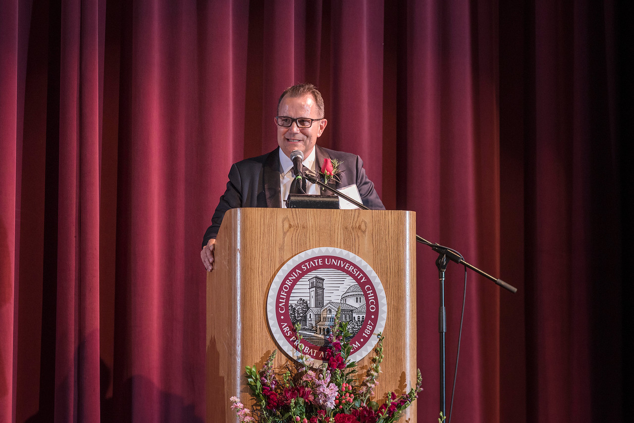 Distinguished Alumni Tom Tognoli (FNMK, '88) is recognized during an evening dinner on Friday, March 9, 2018 in Chico, Calif.  (Jason Halley/University Photographer/CSU Chico)