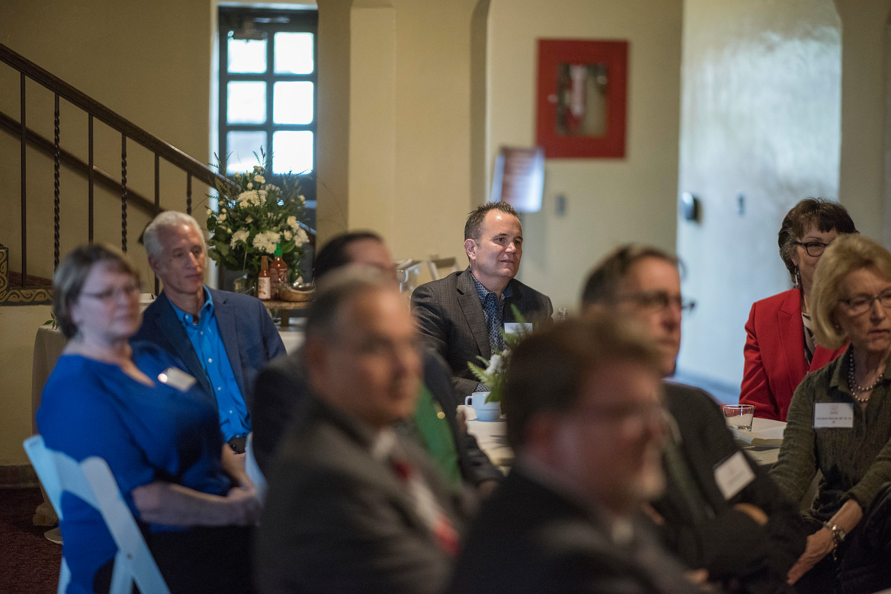 Tom Tognoli (FNMK, '88) (center) and other Distinguished Alumni are recognized during a breakfast with deans and CSAA representative in the Laxson Lobby on Friday, March 9, 2018 in Chico, Calif.  (Jason Halley/University Photographer/CSU Chico)