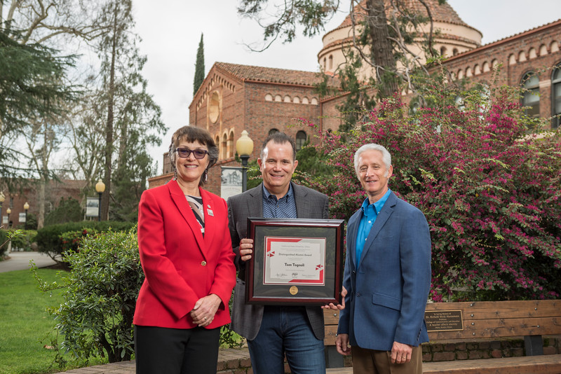 President Gayle Hutchinson, Business 2018 Distinguished Alumni Tom Tognoli (FNMK, '88), Ken Chapman (Dean, COB) (left to right) take a photo after the presentation of plaques on Friday, March 9, 2018 in Chico, Calif.  (Jason Halley/University Photographer/CSU Chico)