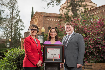 President Gayle Hutchinson, Humanities & Fine Arts 2018 Distinguished Alumni Samia Yaqub (ENGL, '89), Robert Knight (Dean, HFA) (left to right) take a photo after the presentation of plaques on Friday, March 9, 2018 in Chico, Calif.  (Jason Halley/University Photographer/CSU Chico)