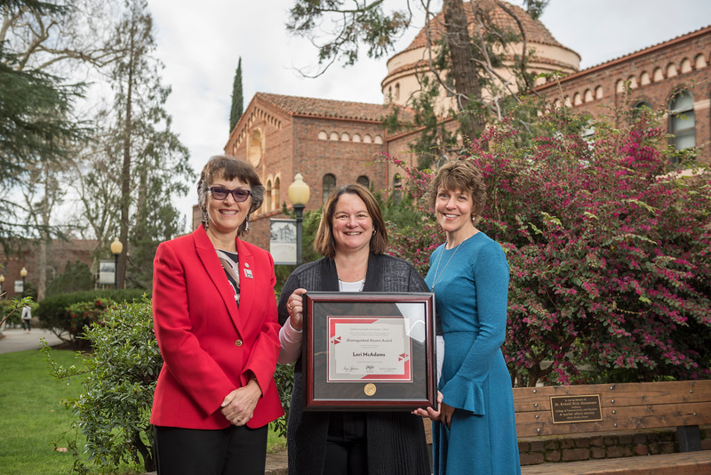 President Gayle Hutchinson, Communication and Education 2018 Distinguished Alumni Lori McAdams (COMM, '83), Angela Trethewey (Dean, CME) (left to right) take a photo after the presentation of plaques on Friday, March 9, 2018 in Chico, Calif.  (Jason Halley/University Photographer/CSU Chico)