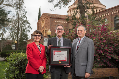 President Gayle Hutchinson, Agriculture 2018 Distinguished Alumni Stephen Jones (AG, '80), John Unruh (Dean, AG) (left to right) take a photo after the presentation of plaques on Friday, March 9, 2018 in Chico, Calif.  (Jason Halley/University Photographer/CSU Chico)