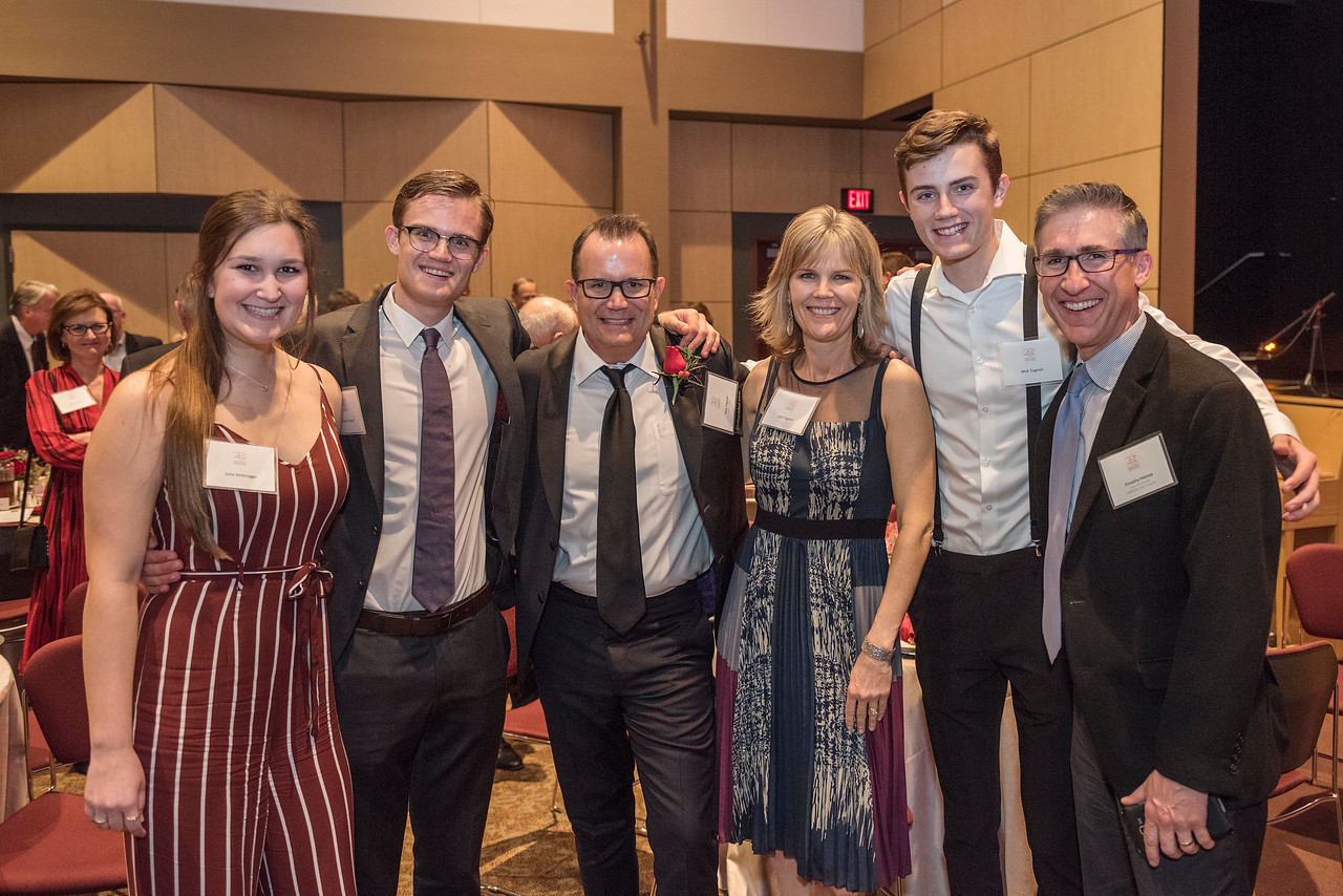 Distinguished Alumni Tom Tognoli (FNMK, '88) (third from left) takes photos with his family after being recognized during an evening dinner on Friday, March 9, 2018 in Chico, Calif.  (Jason Halley/University Photographer/CSU Chico)