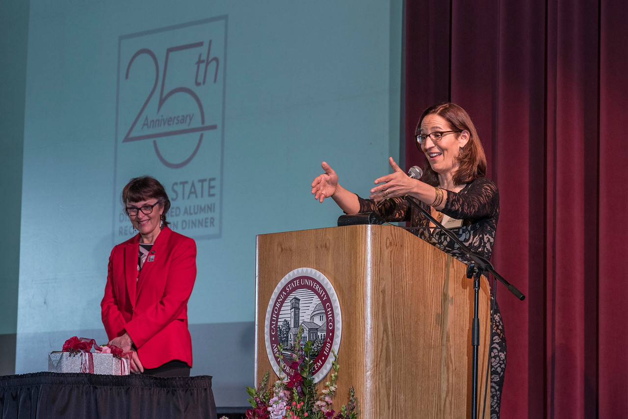 President Gayle Hutchinson (left) recognizes Distinguished Alumni recipient Samia Yaqub (ENGL, '89) (right) during an evening dinner on Friday, March 9, 2018 in Chico, Calif.  (Jason Halley/University Photographer/CSU Chico)