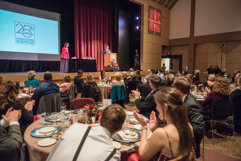 President Gayle Hutchinson (left) recognizes Distinguished Alumni recipient Tom Tognoli (FNMK, '88) (right) during an evening dinner on Friday, March 9, 2018 in Chico, Calif.  (Jason Halley/University Photographer/CSU Chico)