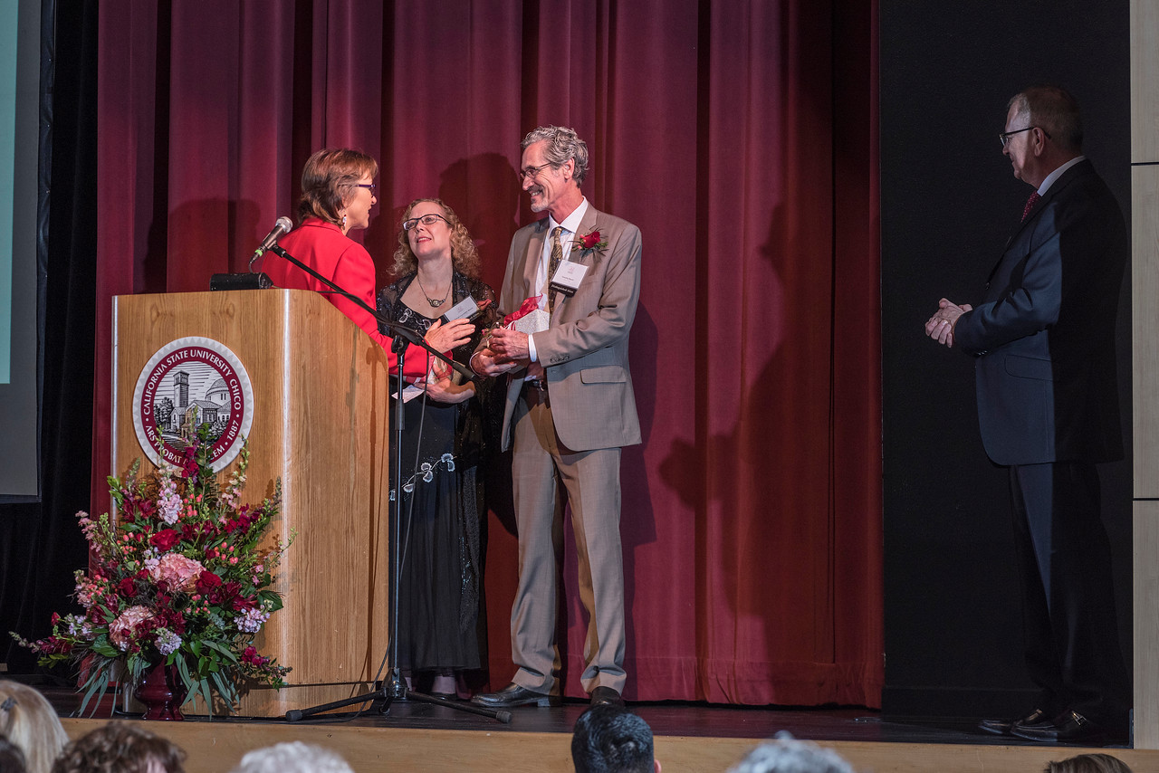 President Gayle Hutchinson recognizes Distinguished Alumni recipient Sheryl Beach (GEOG, '82) and Tim Beach (GEOG, '82) (left to right) during an evening dinner on Friday, March 9, 2018 in Chico, Calif.  (Jason Halley/University Photographer/CSU Chico)