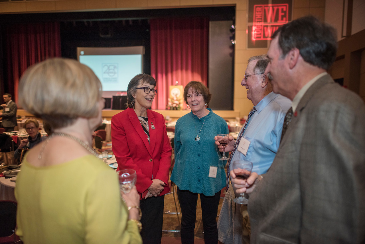 President Gayle Hutchinson, Merrieta Beveridge, David Beveridge, and Tom Carter (left to right) attend the Distinguished Alumni dinner on Friday, March 9, 2018 in Chico, Calif.  (Jason Halley/University Photographer/CSU Chico)