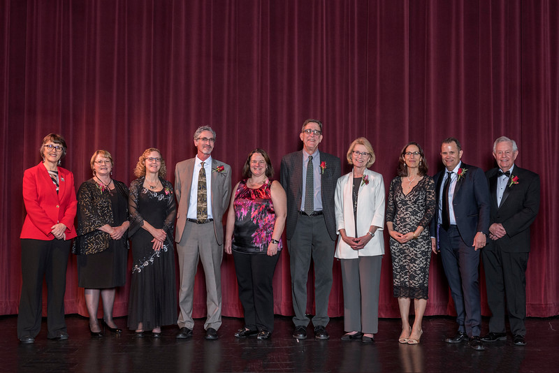 President Gayle Hutchinson with Distinguished Alumni recipients Valerie Lucero (NURS, '83), Sheryl Beach (GEOG, '82), Tim Beach (GEOG, '82), Lori McAdams (COMM, '83), Stephen Jones (AG, '80), Chris Nichols (HIST, '69), Samia Yaqub (ENGL, '89), Tom Tognoli (FNMK, '88),Gary Watters (CIVL, '57), (left to right) that are recognized during an evening dinner on Friday, March 9, 2018 in Chico, Calif.  (Jason Halley/University Photographer/CSU Chico)
