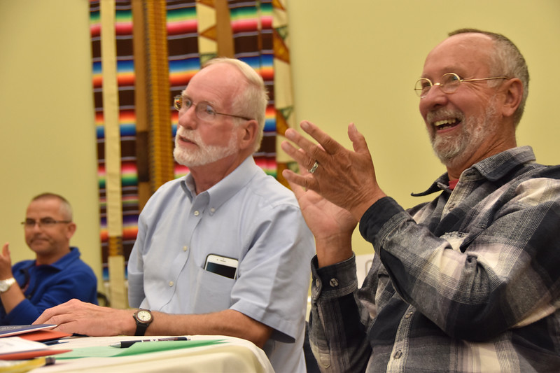 Fr. Byron and others celebrate Fr. Ed's re-election