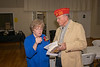 Member and event organizer Marie Taylor discusses event with Commandant Jim O'Kelley