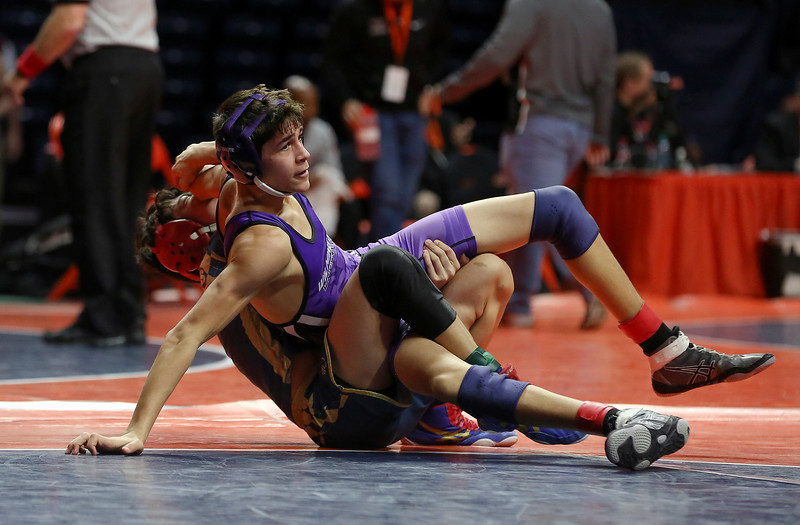 Wilmington's Jack Narine falls to Althoff Catholic's Matthew Minick on Saturday, Feb. 17, 2018, at the State Farm Center during Class 1A State Wrestling Finals in Champaign, Ill.