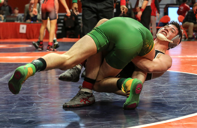 Marmion Academy's Brad Gross lifts Providence Catholic's Cole Smith on Friday, Feb. 16, 2018, at the State Farm Center during Class 3A State Wrestling Semifinals in Champaign, Ill.