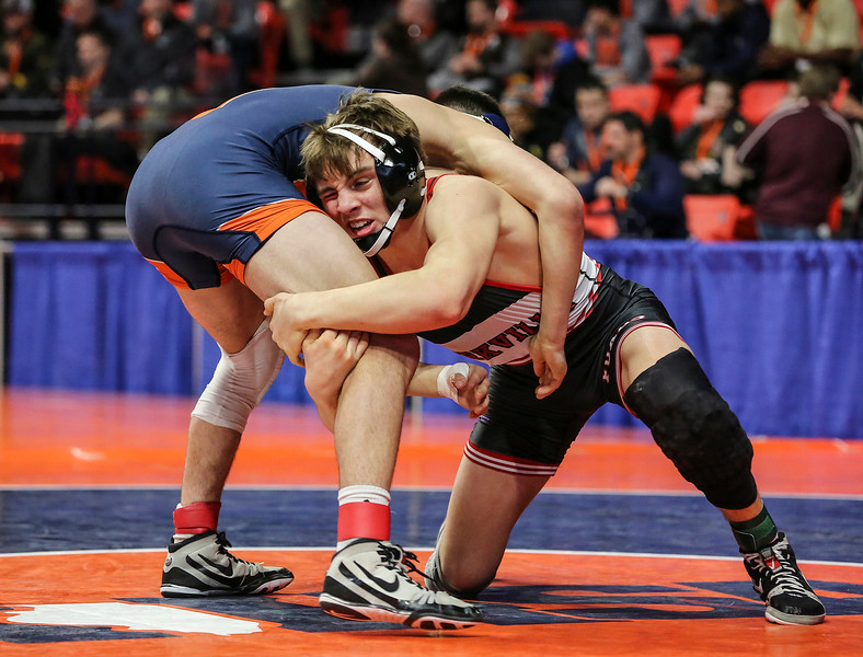 Yorkville's Joe Roberts lunges after Oswego's Gannon Hughes on Saturday, Feb. 17, 2018, at the State Farm Center during Class 3A State Wrestling Finals in Champaign, Ill.