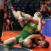 Oswego's Allen Swanson grapples with Providence Catholic's Cole Smith on Saturday, Feb. 17, 2018, at the State Farm Center during Class 3A State Wrestling Finals in Champaign, Ill.