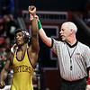 An IHSA referee raises Lockport Township's Anthony Molton's arm on Saturday, Feb. 17, 2018, after defeating Marian's Travis Ford-Melton at the State Farm Center during the Class 3A State Wrestling Championship in Champaign, Ill.