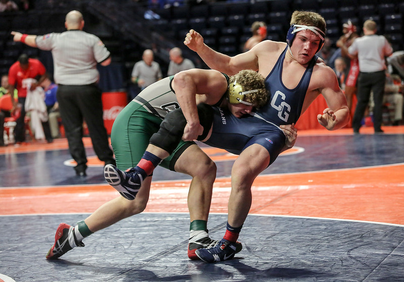 Plainfield Central's Tom Gustafson topples Cary-Grove's Cadin Koeppel on Friday, Feb. 16, 2018, at the State Farm Center during Class 3A State Wrestling Semifinals in Champaign, Ill.