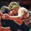 Plainfield Central's Tom Gustafson grapples with Cary-Grove's Cadin Koeppel on Friday, Feb. 16, 2018, at the State Farm Center during Class 3A State Wrestling Semifinals in Champaign, Ill.