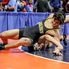 Joliet West's Jonathan Pullen pivots over Marmion Academy's Nate Jimenez on Friday, Feb. 16, 2018, at the State Farm Center during Class 3A State Wrestling Semifinals in Champaign, Ill.