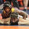 Lockport Township's Anthony Molton tops Montini's Joey Melendez on Friday, Feb. 16, 2018, at the State Farm Center during Class 123A State Wrestling Semifinals in Champaign, Ill.