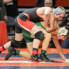 Erie-Prophetstown's Garrett Passmore tops Coal City's Daniel Jezik on Friday, Feb. 16, 2018, at the State Farm Center during Class 1A State Wrestling Semifinals in Champaign, Ill.