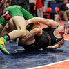 Providence Catholic's Cole Smith slams Marmion Academy's Brad Gross on Friday, Feb. 16, 2018, at the State Farm Center during Class 3A State Wrestling Semifinals in Champaign, Ill.