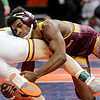 Lockport Township's Anthony Molton brings down Montini's Joey Melendez on Friday, Feb. 16, 2018, at the State Farm Center  during Class 123A State Wrestling Semifinals in Champaign, Ill.