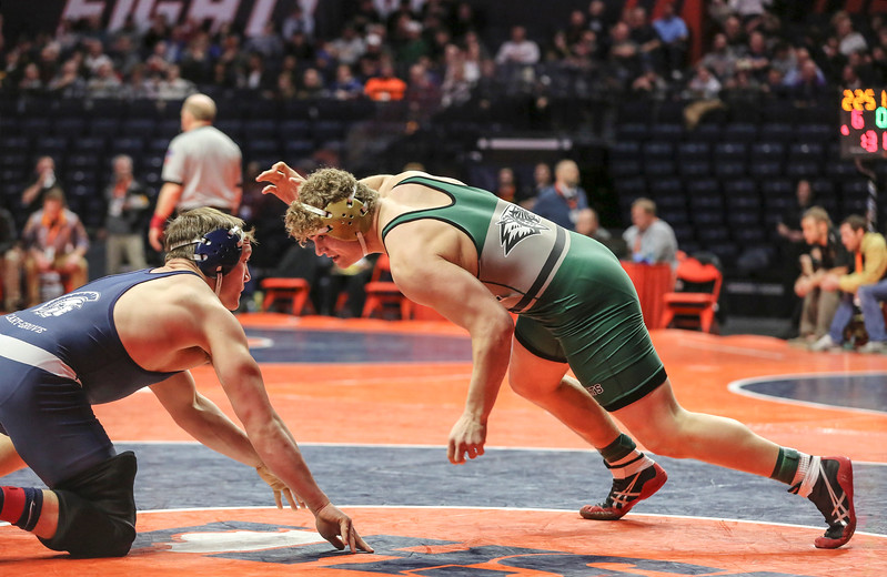 Plainfield Central's Tom Gustafson lunges toward Cary-Grove's Cadin Koeppel on Friday, Feb. 16, 2018, at the State Farm Center during Class 3A State Wrestling Semifinals in Champaign, Ill.