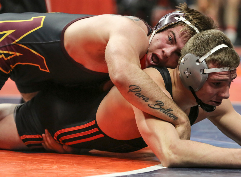 Morris' Cody Baldridge traps Fenton's Dylan Butts on Friday, Feb. 16, 2018, at the State Farm Center during Class 3A State Wrestling Semifinals in Champaign, Ill.