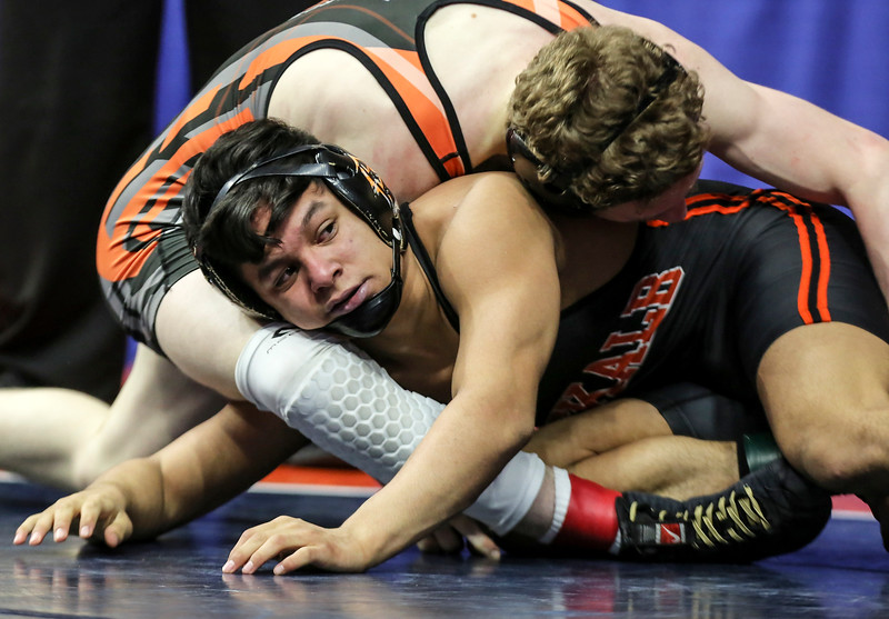 Edwardsville's Luke Odom tops DeKalb's Fabian Lopez on Friday, Feb. 16, 2018, at the State Farm Center during Class 3A State Wrestling Semifinals in Champaign, Ill.