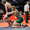 Plainfield Central's Tom Gustafson brings down Cary-Grove's Cadin Koeppel on Friday, Feb. 16, 2018, at the State Farm Center during Class 3A State Wrestling Semifinals in Champaign, Ill.
