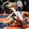 DeKalb's Fabian Lopez grapples with Edwardsville 's Luke Odom on Friday, Feb. 16, 2018, at the State Farm Center  during Class 3A State Wrestling Semifinals in Champaign, Ill.