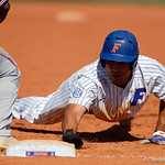 University of Florida Gators first baseman Keenan Bell slides back into first base as the Gators win the series over the Auburn Tigers with a 12-3 game three win.  April 28th, 2018. Gator Country photo by David Bowie.
