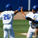 University of Florida Gators infielder Deacon Liput and University of Florida Gators outfielder/pitcher Nick Horvath celebrate as Liput comes across to score as the Gators win the series over the Auburn Tigers with a 12-3 game three win.  April 28th, 2018. Gator Country photo by David Bowie.