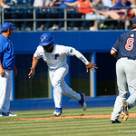 University of Florida Gators outfielder/pitcher Andrew Baker tage third base and sprints home as the Gators win the series over the Auburn Tigers with a 12-3 game three win.  April 28th, 2018. Gator Country photo by David Bowie.