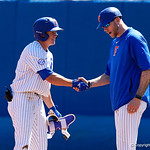 University of Florida Gators infielder/outfielder Blake Reese gets a congratulatory handshake from Volunteer Assistant Coach Lars Davis after Resse singled as the Gators win the series over the Auburn Tigers with a 12-3 game three win.  April 28th, 2018. Gator Country photo by David Bowie.
