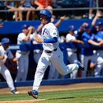 University of Florida Gators outfielder/pitcher Austin Langworthy sprints into home as the Gators score three runs to tie up the game as the Gators win the series over the Auburn Tigers with a 12-3 game three win.  April 28th, 2018. Gator Country photo by David Bowie.