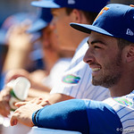 University of Florida Gators infielder Jonathan India smiles on from the dugout as the Gators win the series over the Auburn Tigers with a 12-3 game three win.  April 28th, 2018. Gator Country photo by David Bowie.