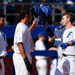 University of Florida Gators infielder Deacon Liput celebrates with University of Florida Gators first baseman Keenan Bell and University of Florida Gators outfielder Nelson Maldonado following Liputs home run as the Gators win the series over the Auburn Tigers with a 12-3 game three win.  April 28th, 2018. Gator Country photo by David Bowie.
