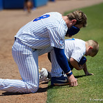 University of Florida Gators infielder Deacon Liput and Finn O'Sullivan kneel down prior to the start of the game as the Gators win the series over the Auburn Tigers with a 12-3 game three win.  April 28th, 2018. Gator Country photo by David Bowie.